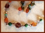 Tangerine Sunflower Wire-Wrapped Necklace Set has lovely autumn colors - orange, green and gold accented with brass wire. https://www.etsy.com/listing/167581255/tangerine-sunflower-wire-wrapped?ref=shop_home_active_10