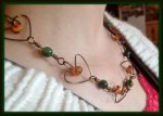 Exquisite Caged Heart, Brass Wire, Orange and Green Stone Necklace Set. https://www.etsy.com/listing/179991272/exquisite-caged-heart-brass-wire-orange?ref=shop_home_active_21