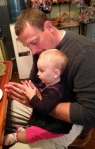 Mike, our son-in-law, teaching Agnes how to say grace!