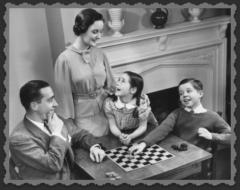 george-marks-family-with-two-children-8-9-playing-checkers_i-g-56-5635-c4cmg00z