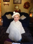 Not willing to be outdone, Agnes also poses with her hat and poncho from her aunts!