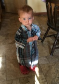 A Precious Moments Baby....little Zelie wearing her brother's shirt and funny shoes!
