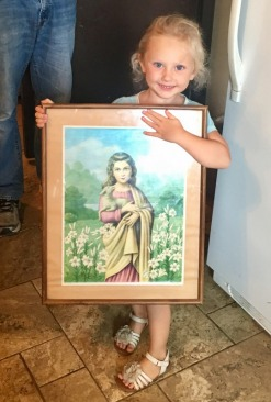 Everything turned out fine...it was a kidney infection. Here is little Agnes with the picture her cousin, Nini, gave her in the hospital...St. Agnes!